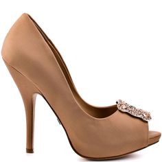 You'll think you're a celebrity in this stunning Badgley Mischka peep toe.  Gayla features an award winning champagne silk upper with a 5 inch heel and 1/2 inch platform.  An inspiring rhinestone and jeweled brooch sits beautifully at the vamp.