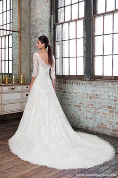 Justin Alexander Signature Spring 2016 Wedding Dresses | Wedding Inspirasi | Romantic Embroidered Beaded Lace Wedding Gown Featuring Illusion Lace 3/4 Length Sleeves, Bateau Neckline, Full Skirt, Chapel+ Length Train; (Back View)>>