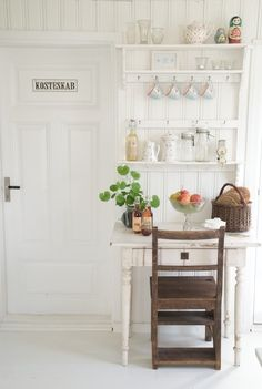 I like the look of white on white..floor to celing beadboard with open shelving is divine!