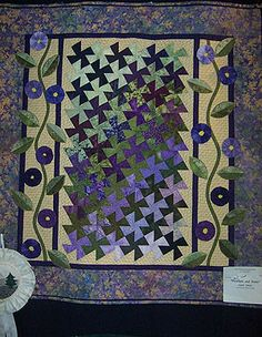 """PINWHEELS AND POSIES"" pieced and applique quilt"