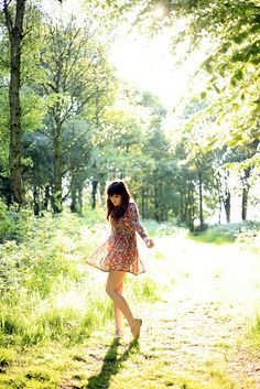 Wear a cute sun dress... go into the forest on a sunny day, spin around in circles, and capture the moment!