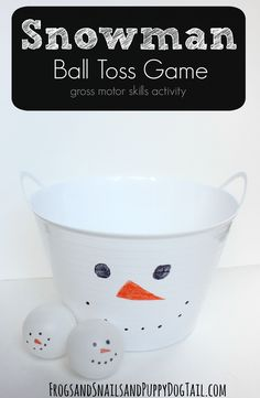 Snowman Ball Toss Game for kids. Great gross motor skill activity for kids. Cheap and easy to make too!