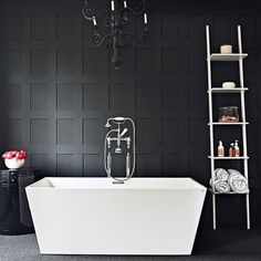 Contemporary black-and-white bathroom - Love the paneled wall and simplicity of the space.
