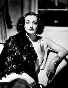 """Joan Crawford in Feathers - the look on her face says to me """"I killed this thing with my bare hands"""""""
