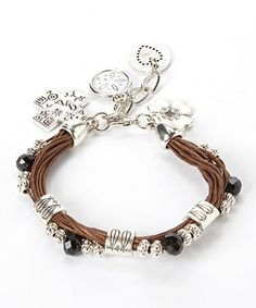This Silvertone & Brown Beaded Clover Charm Bracelet is perfect! #zulilyfinds..WoW$9.99 http://www.zulily.com/invite/cgaebel557