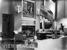 This room is a perfect blend of the Art Deco and Moderne styles o-ular in the 30s. The solid, durable comfort of Moderne is present, but is still influenced by the geometricism of Deco