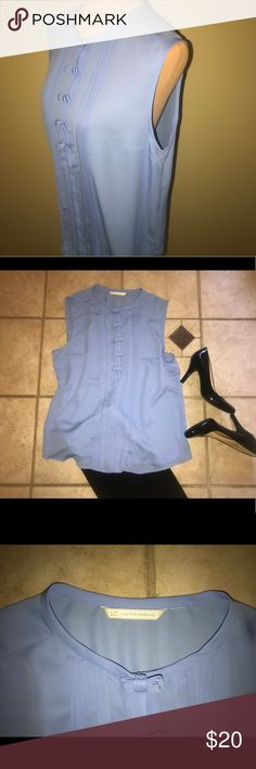 Lauren Conrad Blue Bow Blouse Lauren Conrad Blue Bow Blouse. Perfect condition, flawless. This blouse is some what sheer, featuring cute bows for a snap closure front. Smoke free, pet free home! This blouse does not have the size tag but is a size XL. Please see measurements in photos. LC Lauren Conrad Tops Blouses