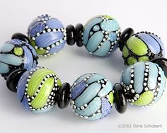 Dora Schubert, beautiful colors ~ could do with simple PC canes and textured dots