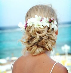Wedding beach hairstyle white tropical flowers with small pinkish flowers.  www.destination-wedding-experts.com
