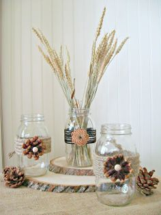 Craft Supplies Needed:  32 oz.Mason Jars Pine Cones Jute Twine Sueded Cording Circular Chipboard Shapes Round Wooden Plugs Craft Saw Glue Gun and Glue Sticks Needle Nose Pliers Strong Scissors