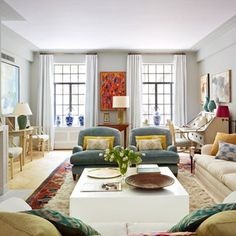 The iconic art-deco building that houses this Manhattan apartment had a subtle influence on its interior decoration, devised by its owner, Anne Dubbs, and her decorator Alexander Doherty. The mirror in living room belonged to Anne's grandmother, while fabrics by Anne's company, Blithfield, are mixed with antique textiles.