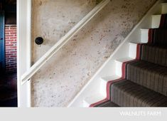 herringbone stair runner, banister, and exposed plaster wall. Walnuts Farm, UK
