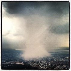 Storm darkens sky over New York City - Dhani Jones