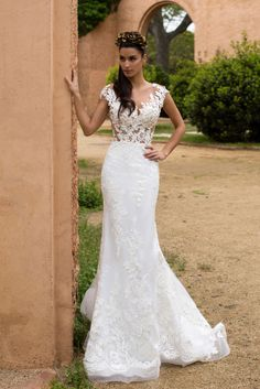 Astonishing mermaid silhouette wedding gown Enrika is made of classy satin and delicate gauze. The corset is decorated with 3D embroidery and flower lace. The back is beautifully buttoned up. Amazing trail may be attached for the additional splendor.