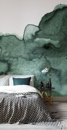 Sink into smokey emerald tones. This watercolour wallpaper design captures layer upon layer of texture and interest for your walls. It's perfect for creating intrigue in modern bedroom spaces.