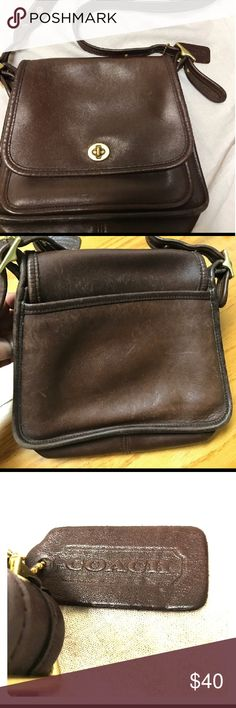 Vintage Coach Brown leather cross body Vintage Coach Legacy Saddle Brown leather Cross body purse shoulder bag. Features a flap lock turn closure gold tone hard ware and leather adjustable strap.  Vintage with minor wear pictured.  Purchased on Posh from another user.  Didn't work for what I purchased it for but it's a beautiful bag that needs a forever home! Coach Bags Crossbody Bags