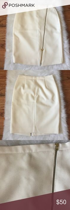 Cream J. Crew Skirt Gorgeous J. Crew Skirt with gold zipper detail. 24 inches long from waist to hem. Waist measures 16 inches flat measurement. J. Crew Skirts Asymmetrical