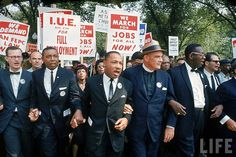 Leaders of March on Washington for Jobs and Freedom marching w. signs (R-L) Matthew Ahmann, Floyd McKissick, Martin Luther King Jr., Rev. Eugene Carson Blake, by Robert W. Kelley 1963