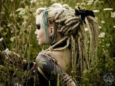 Dread Artist Unknown. Check out Merry's Synthetic Dreads ;)