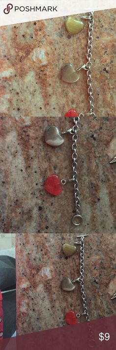 3 Heart charm bracelet Toggle closure 3 heart bracelet. With clip on hearts that are removable and can be placed anywhere on the bracelet; or not at all! Sure to add fun and stylish polished stones with great beauty to any collection! Jewelry Bracelets