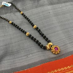 KOPM - Black shining beads with flower pendant
