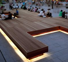 ID Metalco Modular Seating benches with led lighting, within an urban plaza