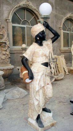 Hand carved marble Blackamoors