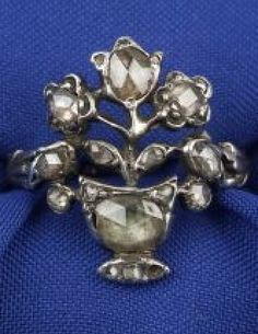 Georgian Giardinetto Ring, designed as an openwork flower in pot, bead-set with rose-cut diamonds, foliate shank, silver-topped 15kt gold mount, together with a Tiffany & Co box, size 4 3/4, (missing one small rose-cut diamond).