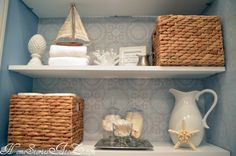 Styling the shelves was what I was most looking forward to! I used items from around the house and raided my craft room for the two baskets. Storage in this bathroom has always been a problem. Now our toilet paper has a home, my girly toiletries have their own basket, and extra hand towels are easy to grab.