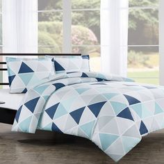 Tribeca by Echelon Home features a modern geometric pattern in shades of blue and gray. Made with 300 thread count, 100% cotton in sateen weave, the stylish Tribeca duvet cover set is the perfect addition to your modern bedroom.
