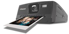 Polaroid Digital Camera... It's a digital camera that actually prints the picture immediately just like the old Polaroids! WANT!