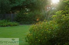 We love overflowing flower beds and crisp green lawns! #StewartLandDesigns