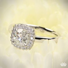 """Selene"" Solitaire Engagement Ring is set in 18k white gold and holds a beautiful 0.817ct A CUT ABOVE® Diamond."