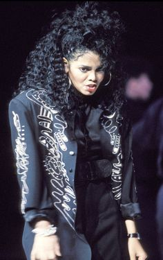 Crimp your hair this Halloween to emulate Janet Jackson's cool '80s style.