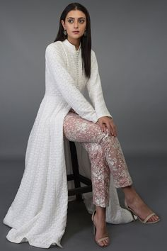 Valentine musing over this Ivory hand embroidered chikankari kalidaar suit. It is teamed with a net floral embroidered cigar pant/skirt enhanced with a nude blush inner taffeta lining. Grab the look for yourself or your loved ones! Indian Fashion Dresses, Dress Indian Style, Pakistani Dresses, Fashion Outfits, Casual Indian Fashion, Cheap Fashion, Salwar Designs, Kurta Designs Women, Kurti Designs Party Wear