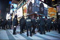 Crystal ball drops in frigid Times Square to mark 2018 - January 1, 2017.  New York City police officers gather at Times Square during New Year's Eve celebrations, Sunday, Dec. 31, 2017, in New York. New Yorkers, celebrity entertainers and tourists from around the world are packing into a frigid Times Square Sunday to mark the start of 2018 with a glittering crystal ball drop, a burst of more than a ton of confetti and midnight fireworks. (AP Photo/Go Nakamura)