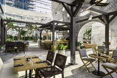 East Miami Hotel bar, Miami. external dining and drink area. green courtyard with canopies above