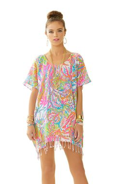 The Avette Caftan is a cover-up with cut out details at the hem. You can wear this to the beach or with a tank and white jeans. It's chic and versatile which makes it the perfect piece to take on vacation.