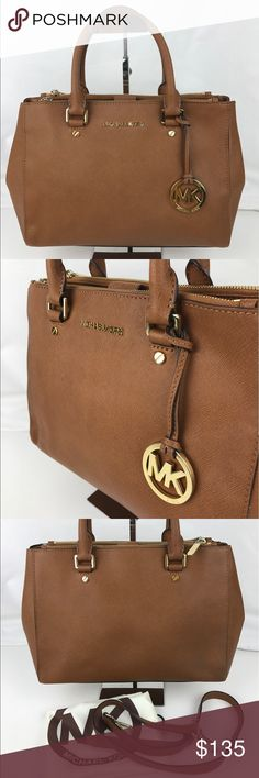 Michael Kors Sutton Leather Medium Satchel Handbag Authentic. Gently used with dust bag and crossbody strap. Minor wear on exterior edges. Handles in good condition with some marks on inside liner.   Saffiano leather. Rolled handles with removable, adjust