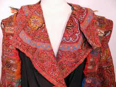 Antique Kashmir Hand Embroidered Woven Wool Pieced Paisley Long Duster Coat. It is made of colorful soft Kashmir wool hand embroidered and pieced together  in a paisley pine cone shaped tear drop motif  boteh and decorative floral leaf designs. The coat was custom made and created from an early 19th century Kashmir paisley shawl, with wonderful workmanship and design.
