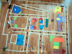 Masking tape town. Great for teaching about your neighborhood and perfect for lots of creativity and fun.