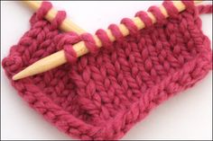 Left-Leaning Double Decreases: Slip 1, knit 2 together, pass slipped stitch over (sl 1, k2tog, psso) by Sandi Rosner. While the right hand stitch ends up on the top of the group, the center stitch falls to the bottom, emphasizing the 2 outer stitches coming together in the center.