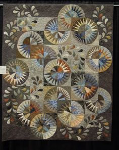 Kathy Martin made this quilt for her son Rob, using the New York Beauty pattern of points arrayed in circular arcs.