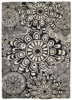 The Black + White Floral Rug from Urban Barn is a unique home decor item. Urban Barn carries a variety of Rugs and other  products furnishings.