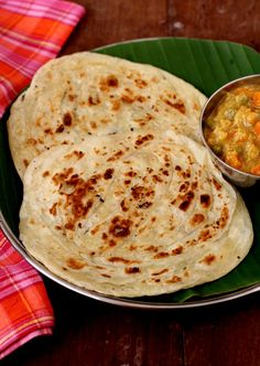 Parotta Recipe - popular South Indian street food fare that is usually served with mixed vegetable curry or salna. www.sailusfood.com