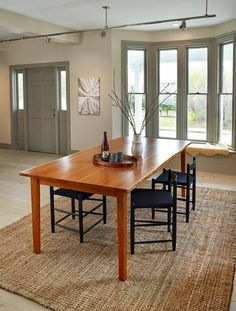 Acadia Dining Table with live edge sides. Combines minimalist Shaker styling with Japanese-inspired respect for nature. The live edge, which is the natural contour of the wood beneath the bark, is preserved on each of the long edges of this dining table. Designed and built in Maine.