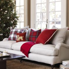 love, love, love this pretty little sofa dressed for the holidays. The crisp white and red is so simple and homey....    CHIC COASTAL LIVING