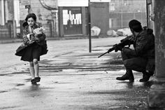 """♥ Harry Benson ♥ Girl and British Soldier, Belfast, Ireland Harry Benson, War Photography, Documentary Photography, Inspiring Photography, British Soldier, British Army, Northern Ireland Troubles, Irish Republican Army, Carpe Diem"
