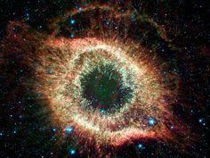 La galassia vortice  Immagine per gentile concessione di R. Kennicutt, U. Arizona, e Caltech/NASA  Questa immagine a quattro colori della galassia vortice è stata scattata prima che Spitzer esaurisse il fluido di raffreddamento.  Combinata con un'immagine nello spettro della luce visibi