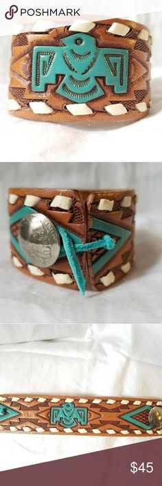 Thunderbird Hand Tooled Leather Cuff Bracelet Beautiful vintage hand carved and painted buck stitched leather belt repurposed by me into a cuff bracelet with a genuine Indian head nickel Concho for the deerskin wrap around tie closure. Adjustable fitting size 6 and up. #southwest #Navajo #NativeAmerican Vintage Jewelry Bracelets